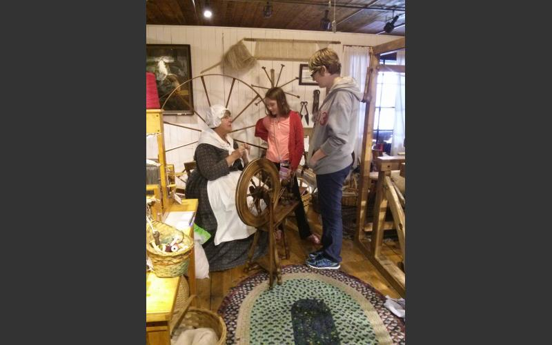 Visitors learning about yarn spinning.